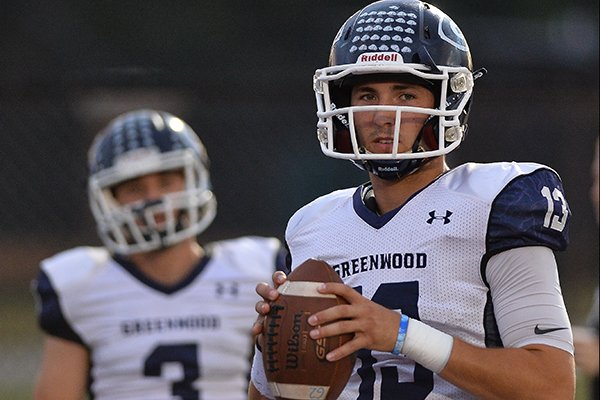 Greenwood quarterback Connor Noland warms up prior to a game against Benton on Friday, Oct. 20, 2017, in Benton.
