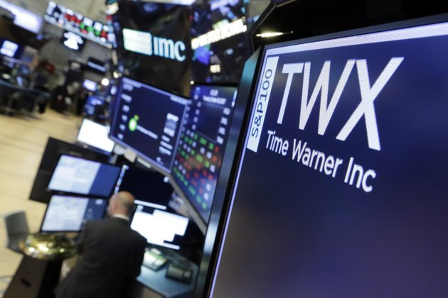 the-symbol-for-time-warner-appears-on-a-board-above-the-floor-of-the-new-york-stock-exchange-thursday-oct-26-2017-time-warner-inc-reported-financial-results-for-its-third-quarter-that-ended-sept-30-2017-ap-photorichard-drew