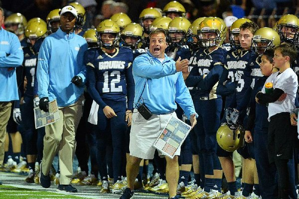 Pulaski Academy head coach Kevin Kelley (center) shouts instructions to his players during Friday night's game against McClellan at Joe B. Hatcher stadium in Little Rock.  Special to the Democrat-Gazette/JIMMY JONES