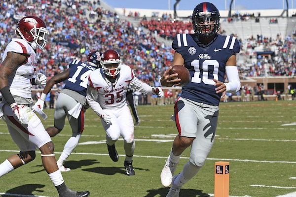 Mississippi quarterback Jordan Ta'amu (10) runs for an 8-yard touchdown run during the first half of an NCAA college football game against Arkansas in Oxford, Miss., Saturday, Oct. 28, 2017. (AP Photo/Thomas Graning)