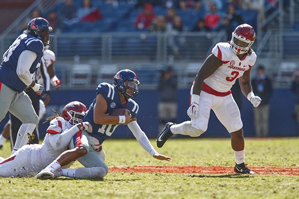 Arkansas defensive end McTelvin Agim (3) watches while Ole Miss quarterback Jordan Ta'amu is tackled during a game Saturday, Oct. 28, 2017, in Oxford, Miss.