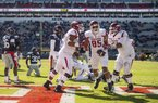 Hawgs Illustrated/BEN GOFF  Colton Jackson (from left), Arkansas tackle, Cheyenne O'Grady (85), Arkansas tight end, and Johnny Gibson, Arkansas tackle, celebrate after O'Grady scored a touchdown in the third quarter against Ole Miss Saturday, Oct. 28, 2017, at Vaught-Hemingway Stadium in Oxford, Miss.