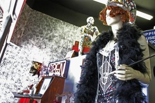 The storefront display for Oddities, Novelties and More recreates how the Madam's room looked when the building was still known as The Crystal Hotel along with a mannequin of how Madam Betty Fortenberry may have looked while working. Terrance Armstard/News-Times