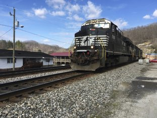 In this Feb. 16 file photo, a Norfolk Southern coal train runs through Kermit, WV. Norfolk Southern Railway must replace millions of defective wooden railroad ties on its tracks because they're degrading faster than expected, the company said in a federal lawsuit filed in October 2017 in U.S. District Court in Alabama. Norfolk Southern Railway blames an Alabama company that produced its railroad ties of failing to use proper protective coating on more than 4.7 million of them. (AP Photo/Michael Virtanen, File)