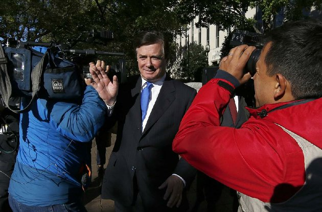 paul-manafort-makes-his-way-through-television-cameras-monday-as-he-walks-from-federal-district-court-in-washington-after-pleading-innocent-to-felony-charges-of-conspiracy-against-the-united-states-and-other-counts
