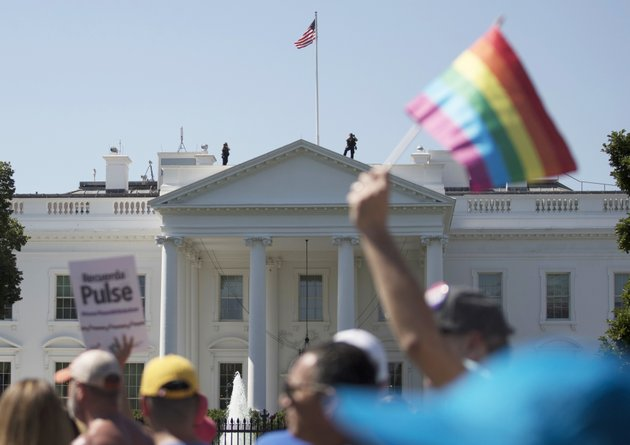 in-this-sunday-june-11-2017-file-photo-equality-march-for-unity-and-pride-participants-march-past-the-white-house-in-washington