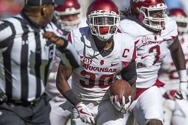 Arkansas defensive back Kevin Richardson returns a fumble for a touchdown during the fourth quarter of a game against Ole Miss on Saturday, Oct. 28, 2017, in Oxford, Miss. The Razorbacks won 38-37.