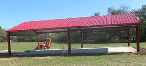 Photo by Susan Holland A spacious pavilion with a red metal roof, concrete floor and adjoining sidewalks was recently completed on the grounds of the Hiwasse Community Center. Gravette City Council members, at their meeting Oct. 26, accepted a bid from Electrical Resources for remodeling work on the Community Center building. Outdoor restrooms are being built and playground equipment will be installed soon.