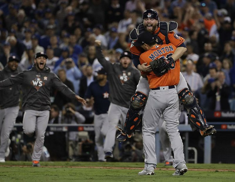 buy popular e1e8c 8dfc0 Houston Astros catcher Brian McCann leaps into the arms of pitcher Charlie  Morton after the Astros defeated the Los Angeles Dodgers 5-1 in Game 7 of  the ...