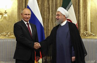 The Associated Press RUSSIAN RELATIONS: In this photo released by an official website of the office of the Iranian Presidency, Iran's President Hassan Rouhani, right, shakes hands with Russian President Vladimir Putin Wednesday at the Saadabad Palace in Tehran, Iran. After watching for years as the United States called the shots in the region, Russian President Vladimir Putin is seizing the reins of power in the Middle East, establishing footholds and striking alliances with unlikely partners. From Syria's battlefields to its burgeoning partnership with Iran and Turkey to its deepening ties with Saudi Arabia, Russia is stepping in to fill a void left by the United States.