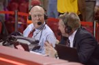 Arkansas basketball play-by-play announcer Chuck Barrett, left, and color analyst Matt Zimmerman talk during a game against Ole Miss on Saturday, Feb. 18, 2017, in Fayetteville.