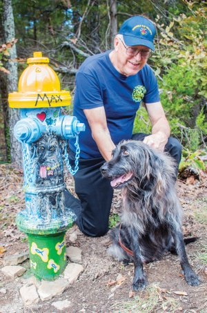 Steve Sutay adopted a fire hydrant from the Fairfield Bay Hydrants for a Cause project and had the hydrant painted in honor of his Irish wolfhound, Max. Steve and his wife, Shirley, moved to Fairfield Bay 23 years ago from New York, where he was a firefighter; he also served as a firefighter in Fairfield Bay. Max is a rescue dog and likes to go fishing with Sutay.