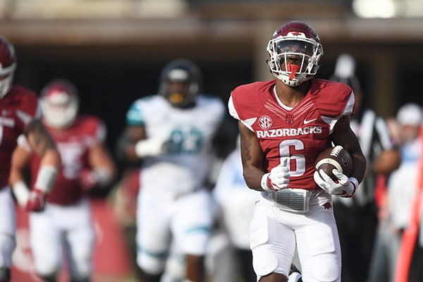 Arkansas running back T.J. Hammonds scores a touchdown during a game against Coastal Carolina on Saturday, Nov. 4, 2017, in Fayetteville.