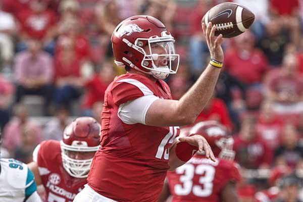 Arkansas quarterback Cole Kelley throws a pass during a game against Coastal Carolina on Saturday, Nov. 4, 2017, in Fayetteville.