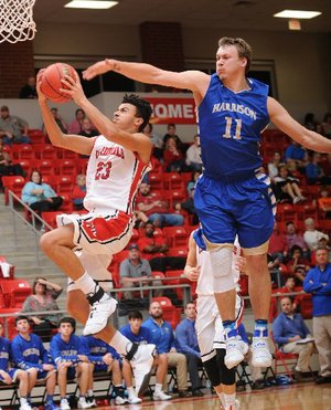 FILE PHOTO Xavier Staten, left, is one of the players Farmington will look to for increased scoring following the graduation of Matt Wilson, who averaged 29 points per game last season. Staten averaged 7.9 for the Cardinals.