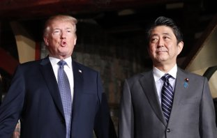 The Associated Press TRUMP: U.S. President Donald Trump, accompanied by Japanese Prime Minister Shinzo Abe, speaks to members of the media before having a dinner at Ginza Ukai Tei restaurant on Sunday in Tokyo. Trump is on a five-country trip through Asia traveling to Japan, South Korea, China, Vietnam and the Philippines.