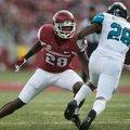 Arkansas Razorbacks defensive back Josh Liddell (28) faces off Coastal Carolina Chanticleers running...