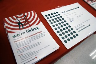 Information on available jobs lies on display Oct. 15 at a Target store in Chicago. On Tuesday, the Labor Department reports on job openings and labor turnover for September. (AP Photo/Nam Y. Huh)