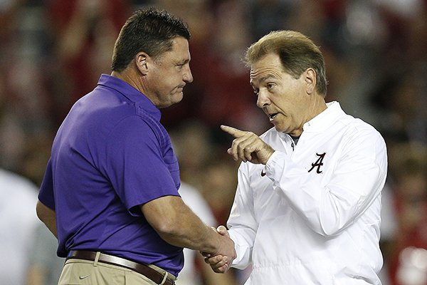 Alabama head coach Nick Saban, right, and LSU head coach Ed Orgeron, left, meet in the center of the field before an NCAA college football game, Saturday, Nov. 4, 2017, in Tuscaloosa, Ala. (AP Photo/Brynn Anderson)