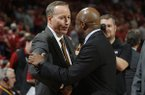 Texas A&M coach Billy Kennedy, left, and Arkansas coach Mike Anderson shake hands prior to a game Wednesday, Feb. 22, 2017, in Fayetteville.