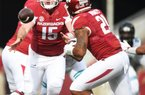 NWA Democrat-Gazette/J.T. WAMPLER Arkansas quarterback Cole Kelley pitches the ball to Devwah Whaley Saturday Nov. 4, 2017 against Coastal Carolina. Arkansas won 39-38.