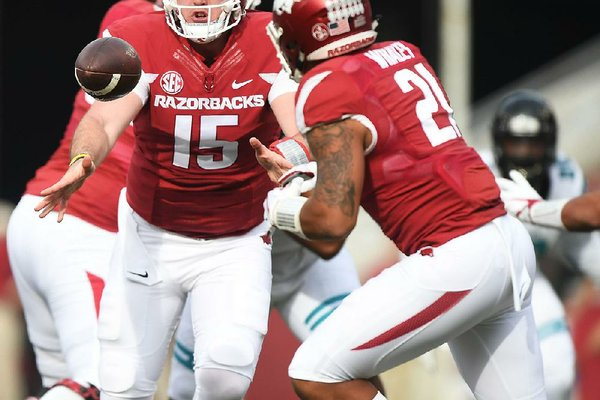 NWA Democrat-Gazette/J.T. WAMPLER Arkansas quarterback Cole Kelley pitches the ball to Devwah Whaley Saturday Nov. 4, 2017 against Coastal Carolina. Arkansas won 39-38.