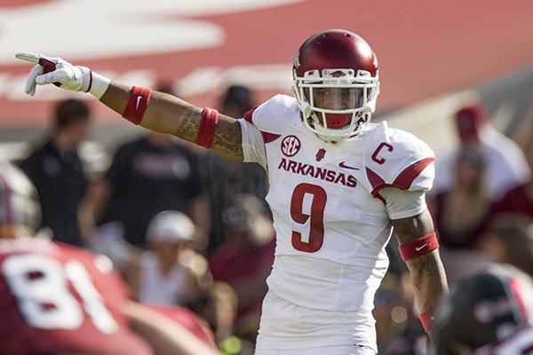 Arkansas safety Santos Ramirez motions prior to a snap during a game against South Carolina on Saturday, Oct. 7, 2017, in Columbia, S.C.