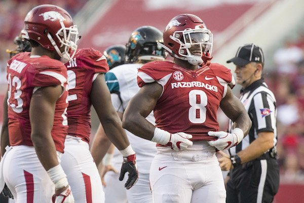 Arkansas linebacker De'Jon Harris reacts after making a tackle against Coastal Carolina on Saturday, Nov. 4, 2017, at Reynolds Razorback Stadium in Fayetteville.