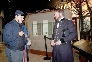LYNN KUTTER ENTERPRISE-LEADER Jim Spillars, portraying General James Blunt, talks to Coby Turney of Lincoln about the Battle of Prairie Grove. Coby was attending the state park's first Night at the Museum.