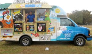 Photo by Susan Holland Antonio Ramirez, a driver for Kona Ice of Bentonville, brought his truck to the Reads for Breeds benefit Saturday, Nov. 4, at the Gravette dog park. He sold snow cones and hot chocolate in a variety of flavors with part of the profits going to the Bella Vista Animal Shelter. He also provided Kanine Kona, shaved ice for the dogs offered for adoption at the event. Books were collected for Gravette Public Library and a face painting booth was a part of the activities.