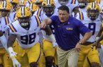 LSU head coach Ed Orgeron leads his team onto the field before an NCAA college football game against Auburn in Baton Rouge, La., Saturday, Oct. 14, 2017. (AP Photo/Matthew Hinton)