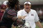 Mississippi State head coach Dan Mullen calls out to a player during the first half of an NCAA college football game against Massachusetts in Starkville, Miss., Saturday, Nov. 4, 2017. (AP Photo/Rogelio V. Solis)