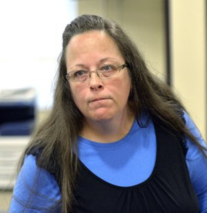 In this Sept. 1, 2015, file photo, Rowan County Clerk Kim Davis listens to a customer at the Rowan County Courthouse in Morehead, Ky. Davis, who spent five days in jail for refusing to issue marriage licenses to same-sex couples, will run for re-election in 2018, the first chance voters will get to have a say on the controversy that dominated national news.