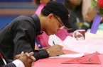 Parkview High School senior Ethan Henderson signs a national letter of intent to play basketball for the University of Arkansas on Wednesday, Nov. 5, 2017, at Parkview High School in Little Rock.