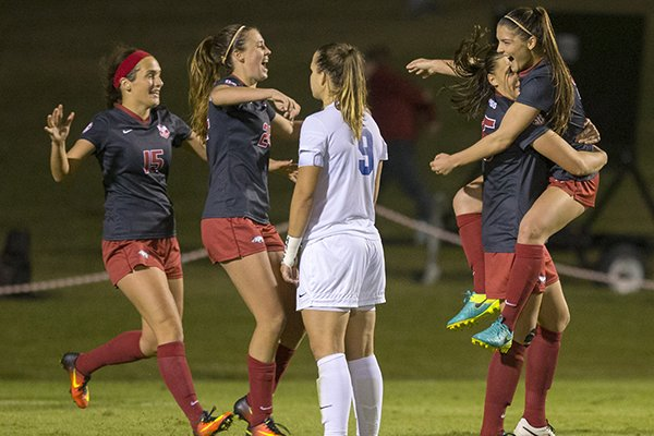 Arkansas' Jessi Hartzler (from left), Kayla McKeon, Lindsey Mayo and Cailee Dennis celebrate as Memphis' Valerie Sanderson (near) watches on Friday, Nov. 11, 2016, after Mayo's game-winning goal in their NCAA tournament first round game at Razorback Field in Fayetteville.