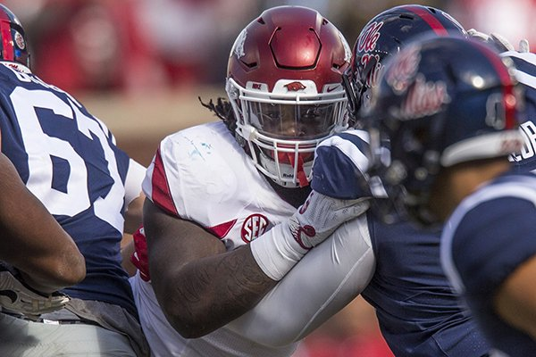 Arkansas defensive end McTelvin Agim is blocked during a game against Ole Miss on Saturday, Oct. 28, 2017, in Oxford, Miss.