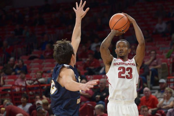 Arkansas guard C.J. Jones (23) takes a three-point shot over Central Oklahoma forward Kyle Keener Friday, Oct. 27, 2017, during the first half in Bud Walton Arena.
