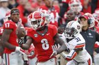 Georgia wide receiver Riley Ridley (8) makes a catch as Auburn defensive back Javaris Davis (31) defends in the first half of an NCAA college football game Saturday, Nov. 12, 2016, in Athens, Ga. (AP Photo/John Bazemore)