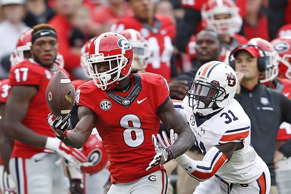 georgia-wide-receiver-riley-ridley-8-makes-a-catch-as-auburn-defensive-back-javaris-davis-31-defends-in-the-first-half-of-an-ncaa-college-football-game-saturday-nov-12-2016-in-athens-ga-ap-photojohn-bazemore