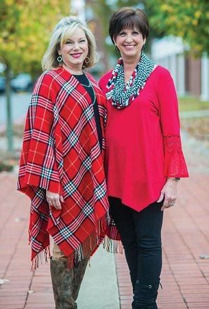 Amy Reed, left, director for development at Central Baptist College in Conway, and Pam Sims, personal enrollment officer, stand together on campus. They are co-chairwomen of the 16th annual Dazzle Daze, the Conway Regional Women's Council's annual fundraiser for the health system. The three-day shopping event is scheduled Thursday through Saturday at the Conway Expo Center.