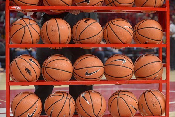 A rack of basketballs is shown during halftime of an exhibition game between Arkansas and Missouri Western on Friday, Nov. 3, 2017, in Fayetteville.