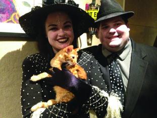 Hannah and Rhett Davis hold their new cat Tony Chachere.