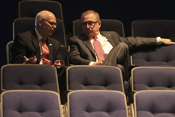 University of Arkansas chancellor Joseph Steinmetz, left, and athletics director Jeff Long sit inside an auditorium at Pulaski Tech during a meeting of the UA Board of Trustees on Thursday, Nov. 9, 2017, in North Little Rock.