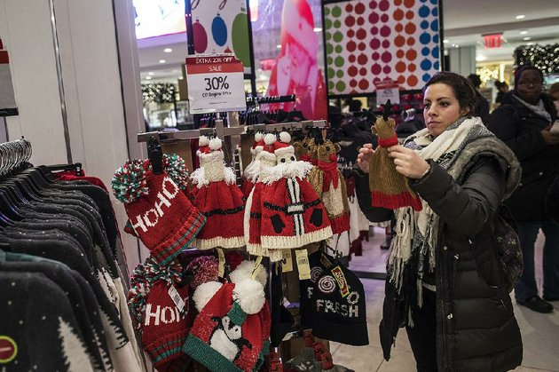 a-shopper-looks-at-hats-displayed-at-a-macys-store-in-new-york-just-before-christmas-last-year-the-retailer-on-thursday-reported-a-third-quarter-profit-of-36-million