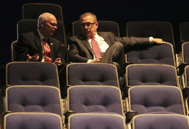 university-of-arkansas-chancellor-joe-steinmetz-left-talks-with-athletic-director-jeff-long-before-a-ua-board-of-trustees-meeting-thursday-morning-in-north-little-rock
