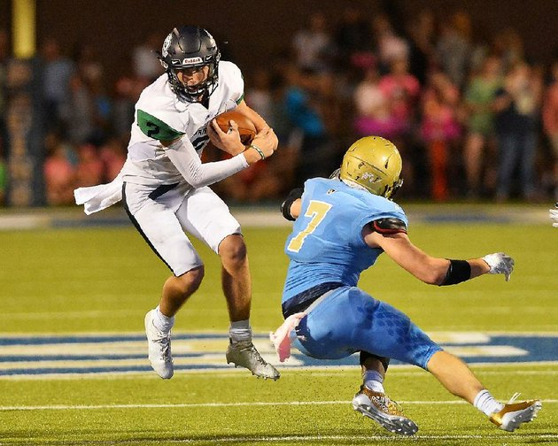 little-rock-christian-quarterback-jackson-bowersock-left-leaps-away-from-pulaski-academy-defender-wesley-wise-during-an-oct-6-game-at-joe-b-hatcher-stadium-in-little-rock-bowersock-and-the-warriors-will-host-wynne-in-a-first-round-playoff-matchup-at-7-tonight
