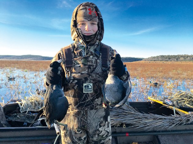 eleven-year-old-tanner-holden-of-benton-holds-a-brace-of-coots-that-will-eventually-grace-his-familys-dinner-table