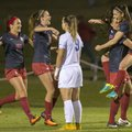 Arkansas' Jessi Hartzler (from left), Kayla McKeon, Lindsey Mayo and Cailee Dennis celebrate as Memp...