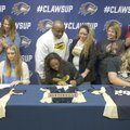 Brittany Crowson (from left), Jazmine Dodd and Anna Griffin sign letters of intent Thursday at Bento...