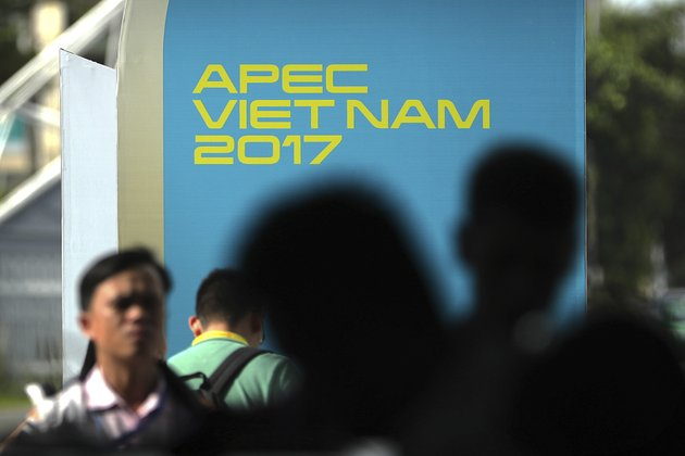 visitors-wait-to-go-through-a-security-check-at-the-media-center-for-asia-pacific-economic-cooperation-apec-leaders-summit-in-danang-vietnam-thursday-nov-9-2017-ap-photomark-schiefelbein